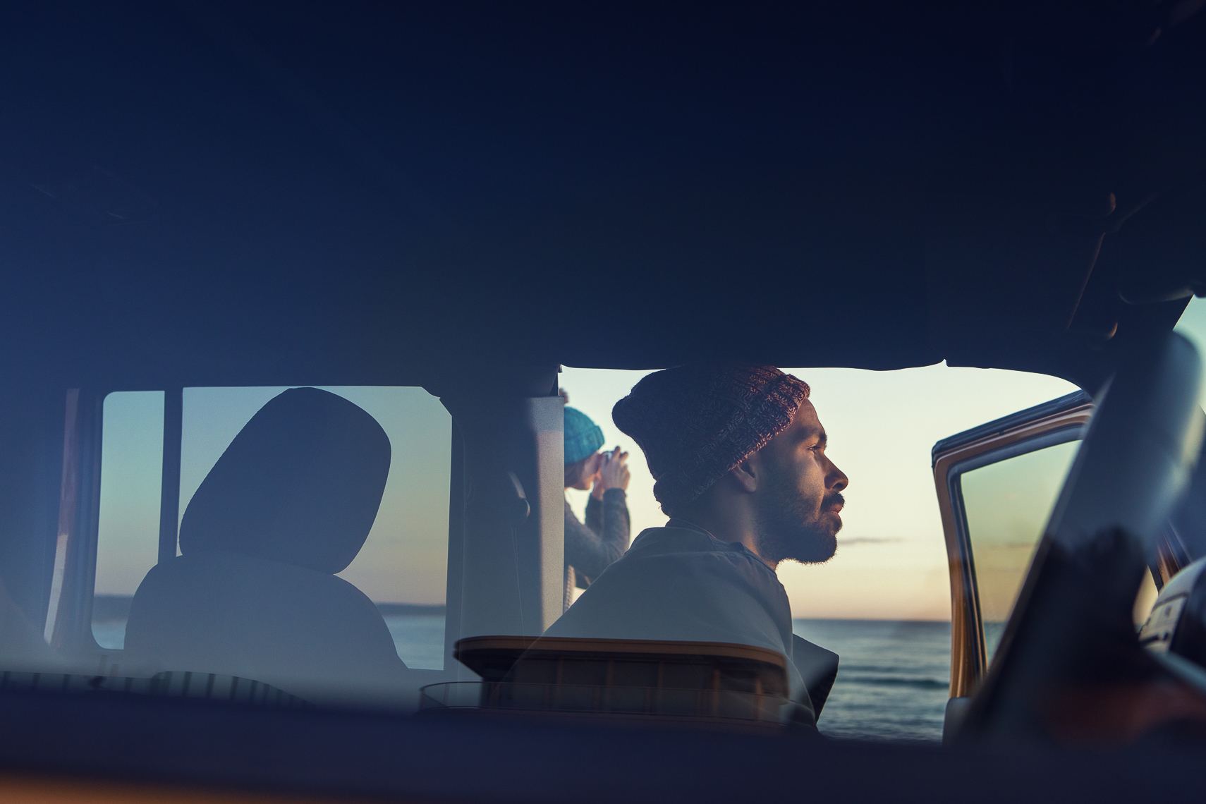 Two friends watching the sunrise in a car in Byron Bay