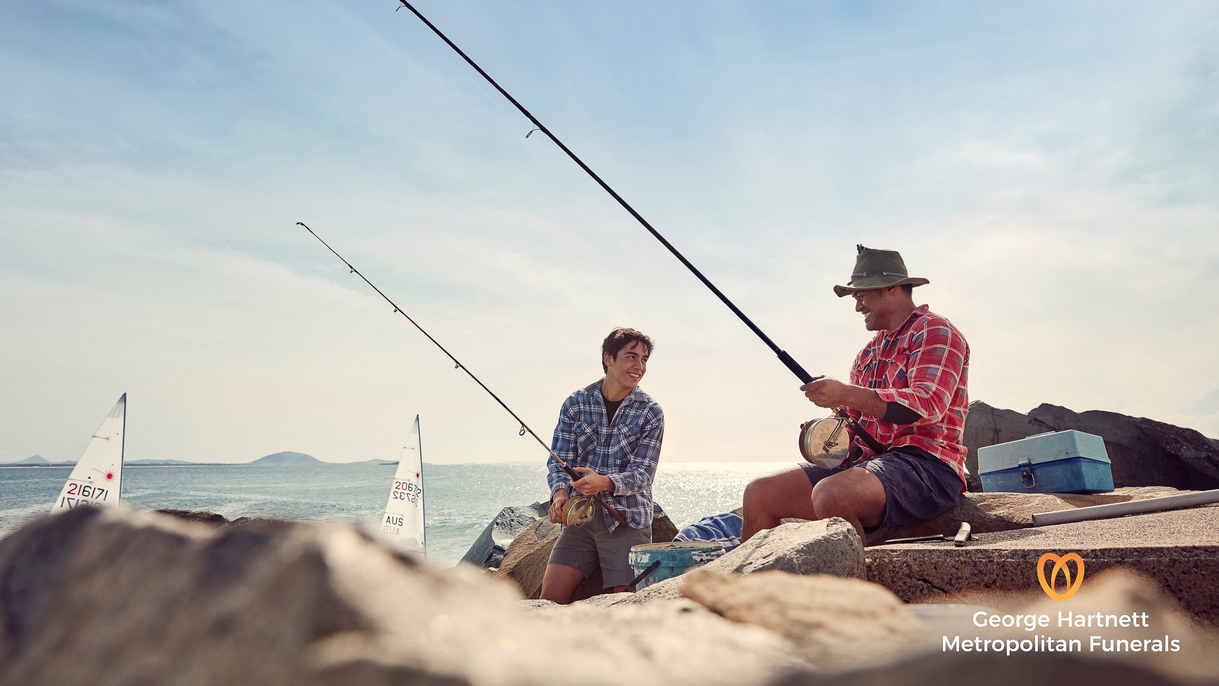 dad and son fishing together for a photography campaign on the sunshine coast
