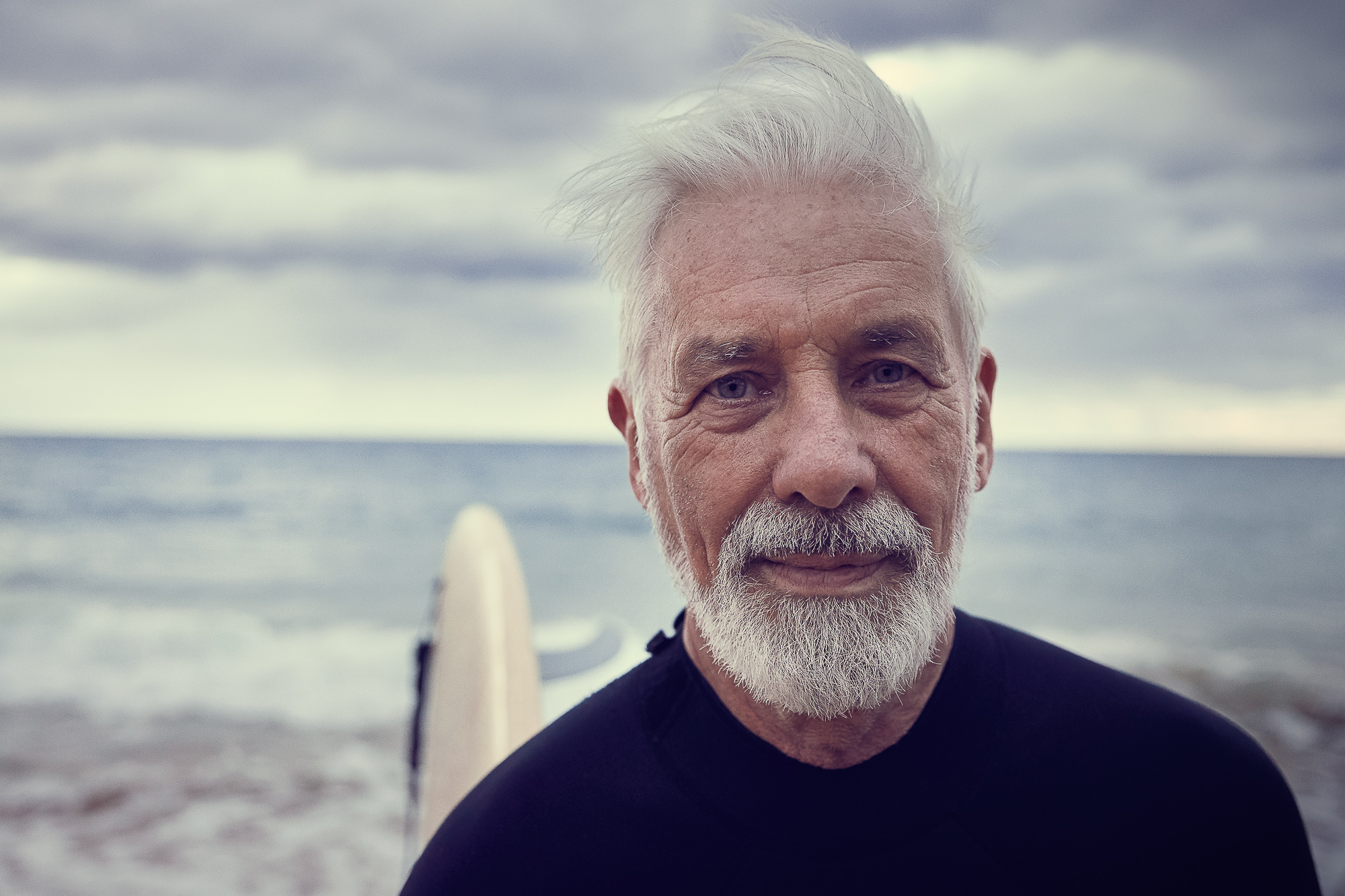 A handsome elderly mangoing for a surf with a friend during a photography campaign in Sydney